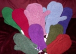 a number of colorful mittens