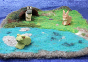 felted playmats with 3 wooden animals and a hidey hole