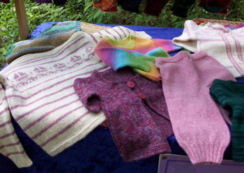 sweaters in a variety of colors and sizes