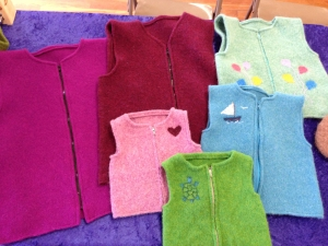 a number of felted vests